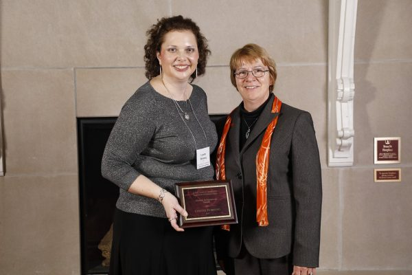 Lynette Horung and Beate Schmittmann, dean of the College of Liberal Arts and Sciences at awards ceremony, with plaque.
